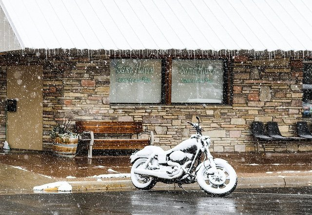 a motorcycle covered in snow.